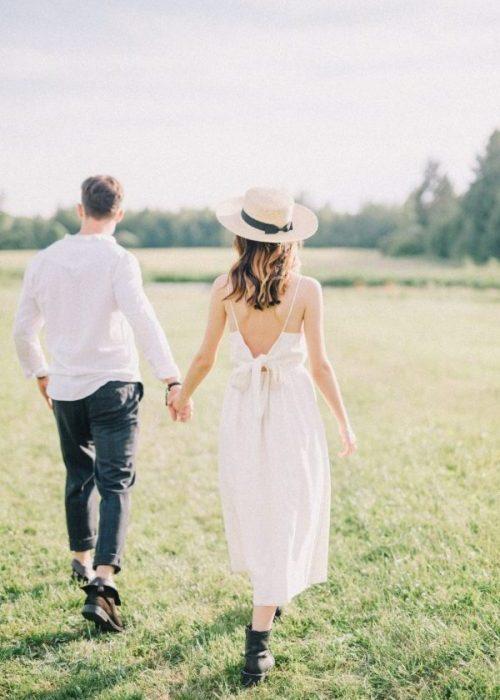 happy couple walking on date